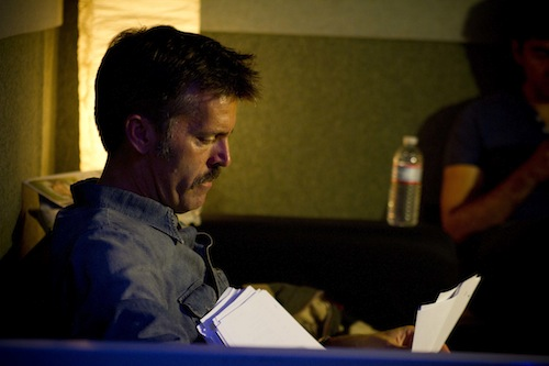 Nathan studies his script.