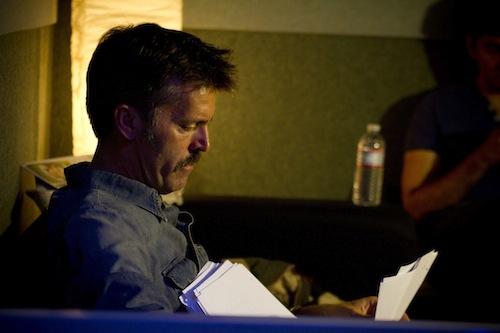 Nathan studies his script.